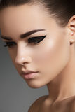 Beautiful model face with fashion eyeliner make-up royalty free stock photography