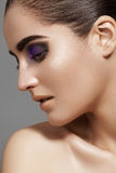 Beautiful model face with fashion eyes make-up, purity skin Royalty Free Stock Photos