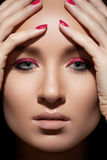 Beautiful model face with fashion make-up & nails Royalty Free Stock Images