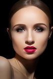 Beautiful model face with hot fashion lips make-up. High fashion beauty model. Close-up portrait of beautiful woman with perfect makeup. Brightly summer hot pink stock photo