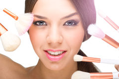 Beautiful model face with make-up brushes Stock Image
