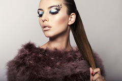 Beautiful model with fantastic eyes makeup Stock Photos
