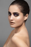 Beautiful model with fashion eyes make-up, clean shiny skin Royalty Free Stock Photos