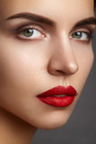Beautiful model with fashion make-up. Close-up portrait woman with glamour lip gloss makeup and bright eye shadows. Royalty Free Stock Image