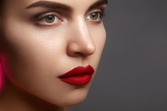 Beautiful model with fashion make-up. Close-up portrait woman with glamour lip gloss makeup and bright eye shadows. royalty free stock photos