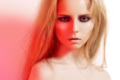 Beautiful model with fashion make-up and long hair stock photography