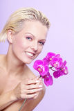 Beautiful model with a flower Royalty Free Stock Photography