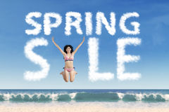 Beautiful model forming spring sale text Royalty Free Stock Images