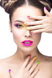 Beautiful model girl with bright colored makeup and nail polish in the summer image. Beauty face. Short colored nails. Royalty Free Stock Photography