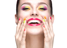 Beautiful model girl with bright colored makeup and nail polish in the summer image. Beauty face. Short colored nails. Royalty Free Stock Image