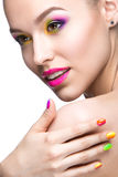 Beautiful model girl with bright colored makeup. And nail polish in the summer image. Beauty face. Short colored nails. Picture taken in the studio on a white Royalty Free Stock Images
