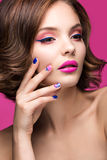 Beautiful model girl with bright pink makeup and Royalty Free Stock Photo
