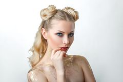 Beautiful model girl with . Fashion makeup, portrait of a young woman on a light background with blond hair stock photos
