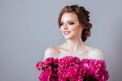 Beautiful model girl with flowers peony stock images
