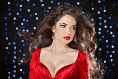 Beautiful model girl with long wavy shiny hair and red lips isol Royalty Free Stock Photography