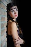 Beautiful model girl upset near brick wall Royalty Free Stock Image