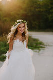 Beautiful model girl in a white wedding dress Stock Photography