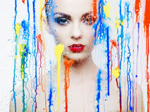 Beautiful model through the glass with bright colors Stock Image