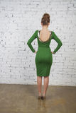 Beautiful model in green dress from beck Royalty Free Stock Photo
