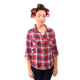 Beautiful model in hair curlers in studio. on white Royalty Free Stock Photography