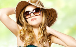 Beautiful model in  hat with glasses. Portrait of beautiful model in  hat with glasses Stock Image