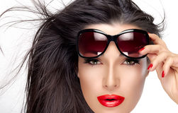 Beautiful Model Holding Fashion Sunglasses on Forehead Royalty Free Stock Photos