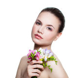 Beautiful Model holding Flowers. Royalty Free Stock Images