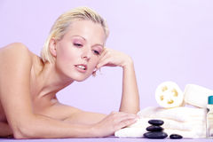 Beautiful model is with hot stones Royalty Free Stock Photos