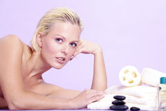 Beautiful model is with hot stones Stock Photos
