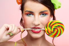 Beautiful model with lollipop Royalty Free Stock Photo