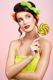 Beautiful model with lollipop Stock Photography