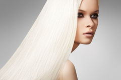 Beautiful model, long blond straight hair style