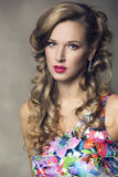 Beautiful model with long curly hair Royalty Free Stock Images