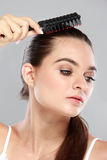 Beautiful model with long hair comb the hair Stock Photos