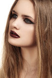 Beautiful model with long hair & grunge dark gloss lips make-up, black liner Stock Photos