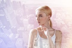 Beautiful model looking away while touching her chin Royalty Free Stock Images
