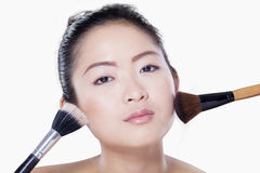 Beautiful model with makeup brush Stock Photo