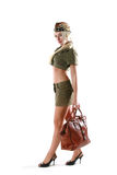 Beautiful model in military clothes with bag Royalty Free Stock Photo