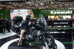 Beautiful model on a motorbike at EICMA 2013 in Milan, Italy Royalty Free Stock Image