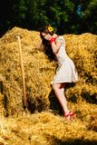 Beautiful model near haystack. Royalty Free Stock Images