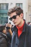 Beautiful model outside Ferragamo fashion show building for Milan Men's Fashion Week 2015 Royalty Free Stock Images