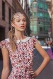 Beautiful model outside Grinko fashion show building for Milan Women's Fashion Week 2014 Stock Photography