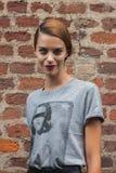 Beautiful model outside Trussardi fashion shows building for Milan Women's Fashion Week 2014 Royalty Free Stock Photography