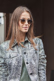 Beautiful model outside Trussardi fashion shows building for Milan Women's Fashion Week 2014 Royalty Free Stock Images
