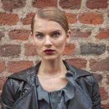 Beautiful model outside Trussardi fashion shows building for Milan Women's Fashion Week 2014 Stock Photo