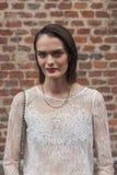 Beautiful model outside Trussardi fashion shows building for Milan Women's Fashion Week 2014 Royalty Free Stock Photo
