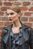 Beautiful model outside Trussardi fashion shows building for Milan Women's Fashion Week 2014 Stock Photography