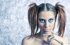 Beautiful model with pigtails, fancy makeup and Royalty Free Stock Photos