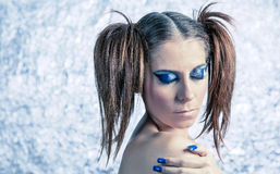 Beautiful model with pigtails, fancy makeup and Royalty Free Stock Images