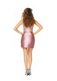 Beautiful model in pink dress. Back view model in pink dress isolated on white Royalty Free Stock Photography